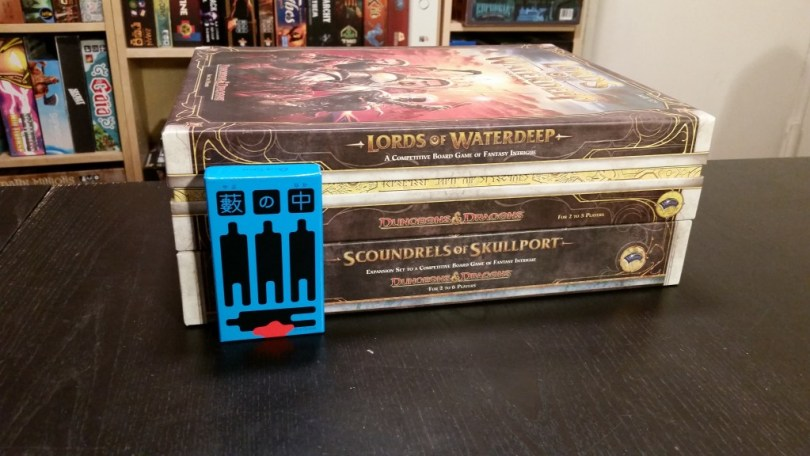 A tiny murder mystery game for scale. Seriously, those boxes are too damn big, and there are two of them!