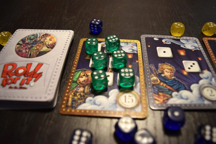 Once you manage to cover all the dice of a given card, you claim it as your own and add it to your score pile!