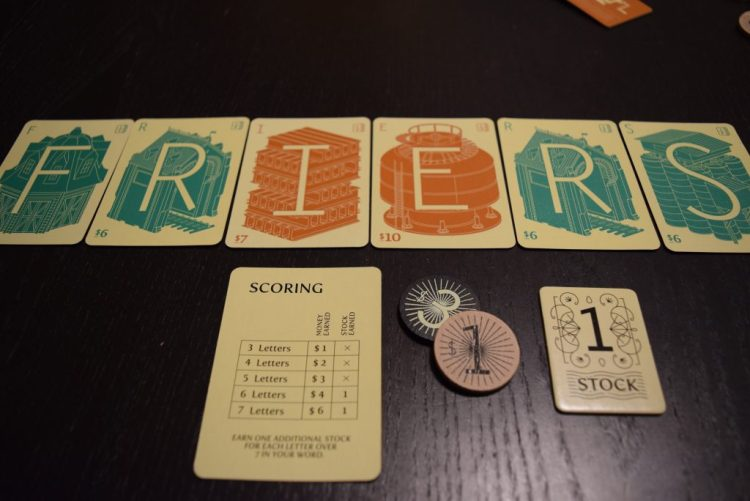 An example of a word and how much you'll get for spelling it. The Stock tiles are Victory points. Also, pro-tip: avoid writing game reviews while hungry.