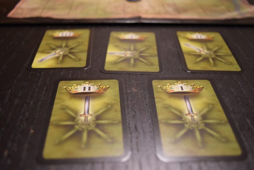 A handful of Power cards. The crown icon matches up with the board, so both players have the same card orientation. Handy!