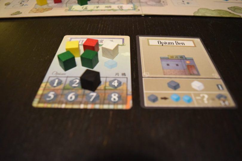 Between turns, players can only retain 6 goods. The black cubes, opium, are a wild good; however, each one spent incurs a point penalty at the end of the game. And if you build an opium den to take even greater advantage of the illicit good, you aren't just penalized for you own opium, but *everyone's*, so consider the risks carefully.