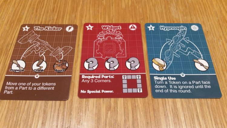 Some gadget cards. The Widget, one of several cards that doesn't require *specific* components but gives no power, feels like it should be worth more points than the Kicker, which is usually just as hard to build and gives a power besides.