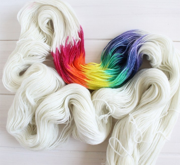 Adventure Time themed hand dyed sparkle yarns: Lady Rainicorn