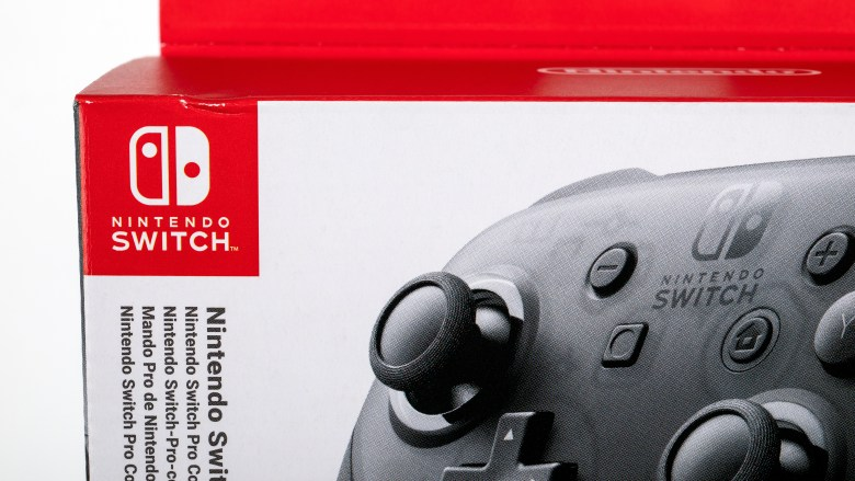 Nintendo Pro Controller in box for Nintendo Switch, black console for gamers on white background