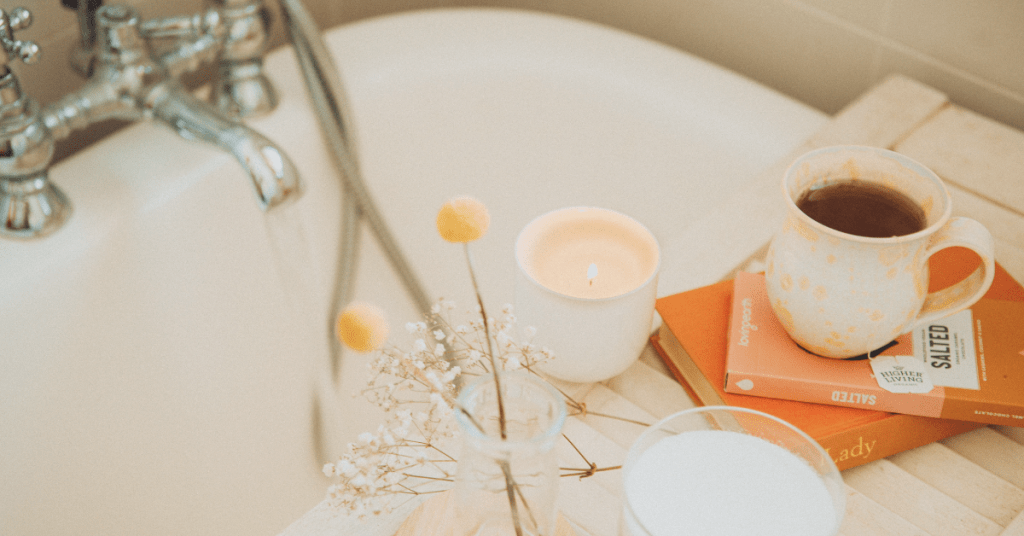 Photo of a bath with candles, books, and coffee for me-time