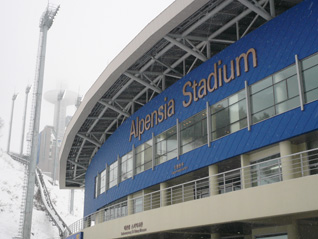 Alpensia Stadium in PyeongChang with ski jump tower in the haze at the upper-left (GamesBids Photo - January 2013)