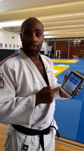 Teddy Riner, Olympic Champion in Judo, using the Paris 2024 Olympic Bid athletes' app (Photo: Paris 2024)