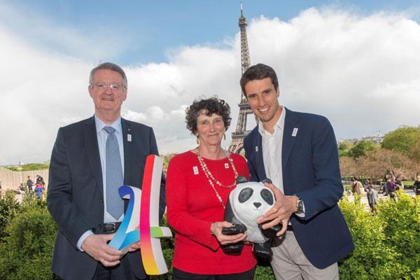 Paris 2024 Co-Chairmen, Bernard Lapasset [left] and Tony Estanguet [right], with WWF France President, Isabelle Autissier [centre]