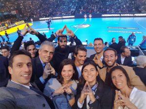 Tony Estanguet and other Paris 2024 members gesture bid logo at Opening of 2017 IHF Handball Men's World Championship in Paris (Paris 2024 Photo)