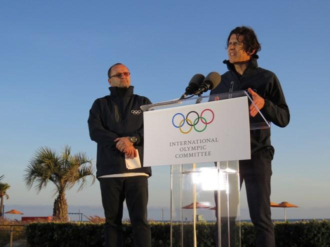 IOC Evaluation Commission Chief Patrick Baumann (left) looks on as IOC Sports Director Christophe Dubi speaks to press at Santa Monica Beach (GamesBids Photo)