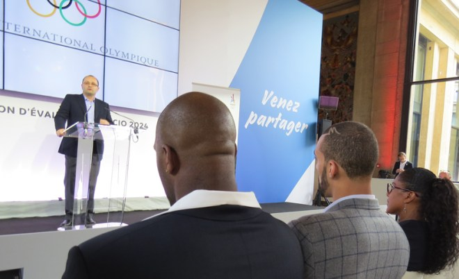 Champion French Judoka Teddy Riner (Left/Front) and NBA Star Rudy Gobert look on as IOC Evaluation Commission Chair Patrick Baumann addressed the press in Paris (GamesBids Photo)