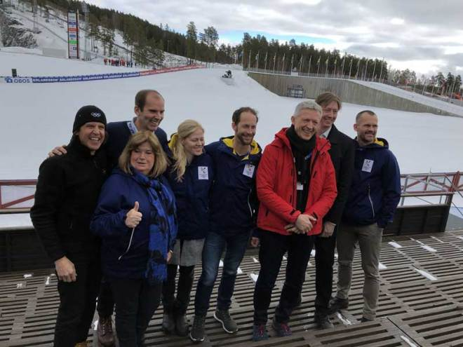IOC Evaluation Commission Chief Octavian Morariu (red jacket) with IOC Executive Director Christophe Dubi (left) and Stockholm-Åre bid Chief Richard Brisius (2nd left) at Lugnet Nordic Complex in Falun, Sweden (GamesBids Photo)