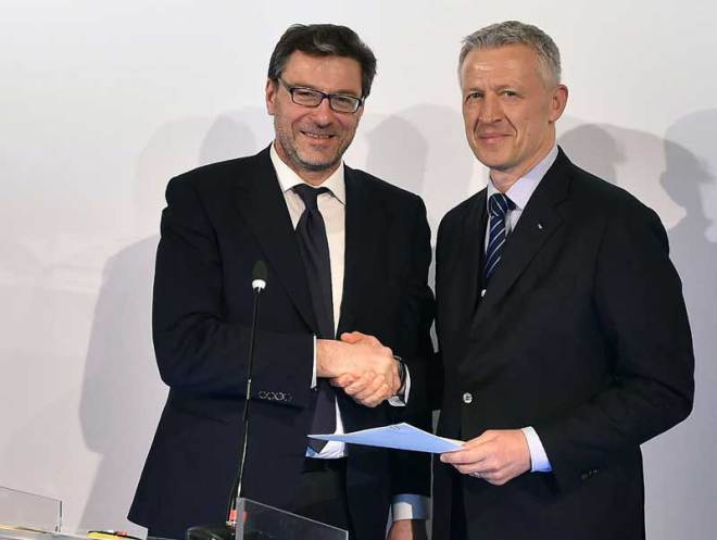 Italian Undersecratary of State Giancarlo Giorgetti at Palazzo Reale in Milan delivers official letter with government guarantees for Milan-Cortina 2026 Olympic bid signed by Italian Prime Minister Giuseppe Conte to IOC Evaluation Commission Chair Octavian Morariu, April 5, 2019 (CONI Photo)