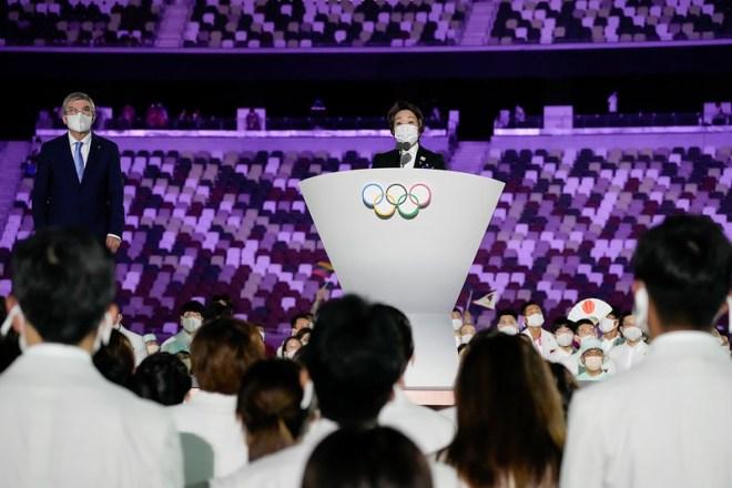 IOC President Thomas Bach (left) and Tokyo 2020 President Hashimoto Seiko on podium at Tokyo 2020 Olympic Games Opening Ceremony July 23, 2021 (IOC Photo)