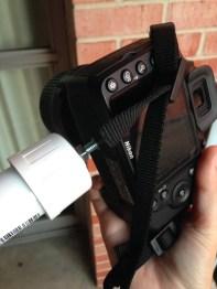 The PVC mount screws into the bottom of DSLR cameras.