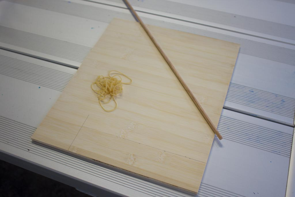 Wood, Rubber bands, and a wooden dowel rod