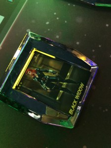 Black Widow card being scanned on Marvel contest of champions at dave and buster's