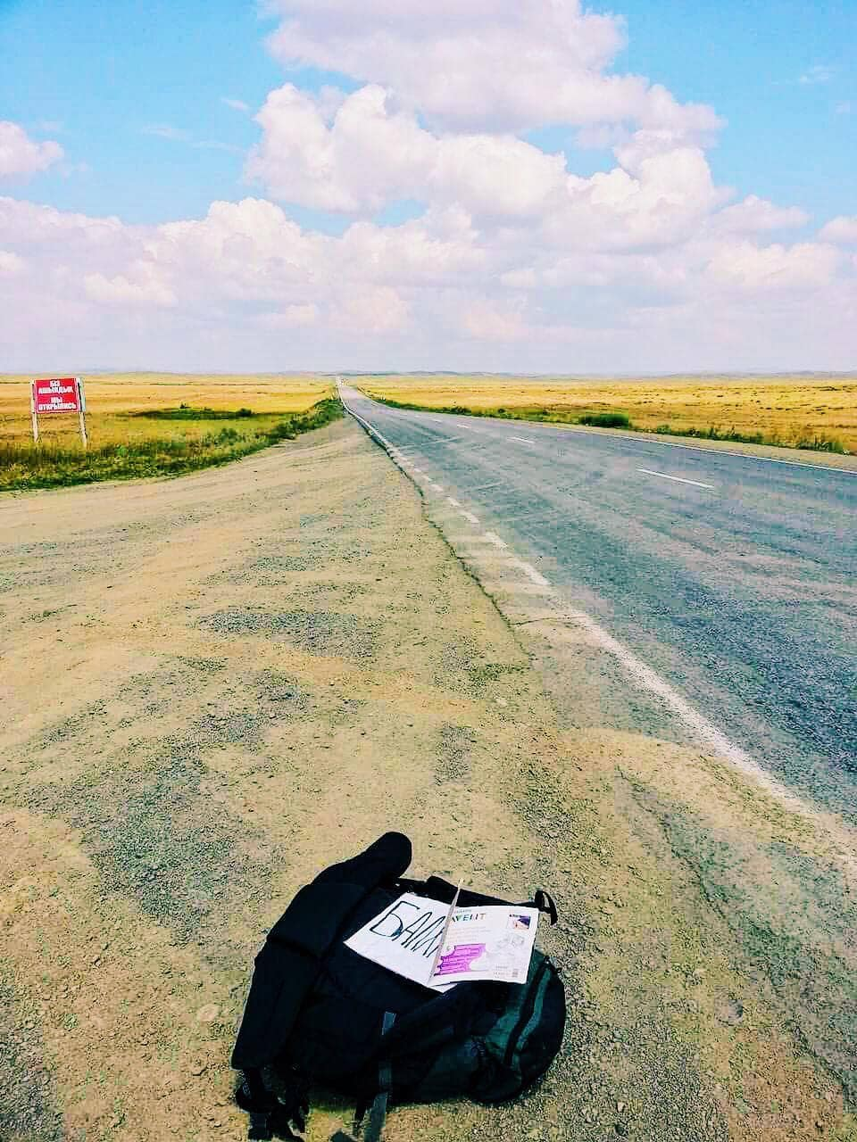 Hitchhiking in the middle of nowhere.