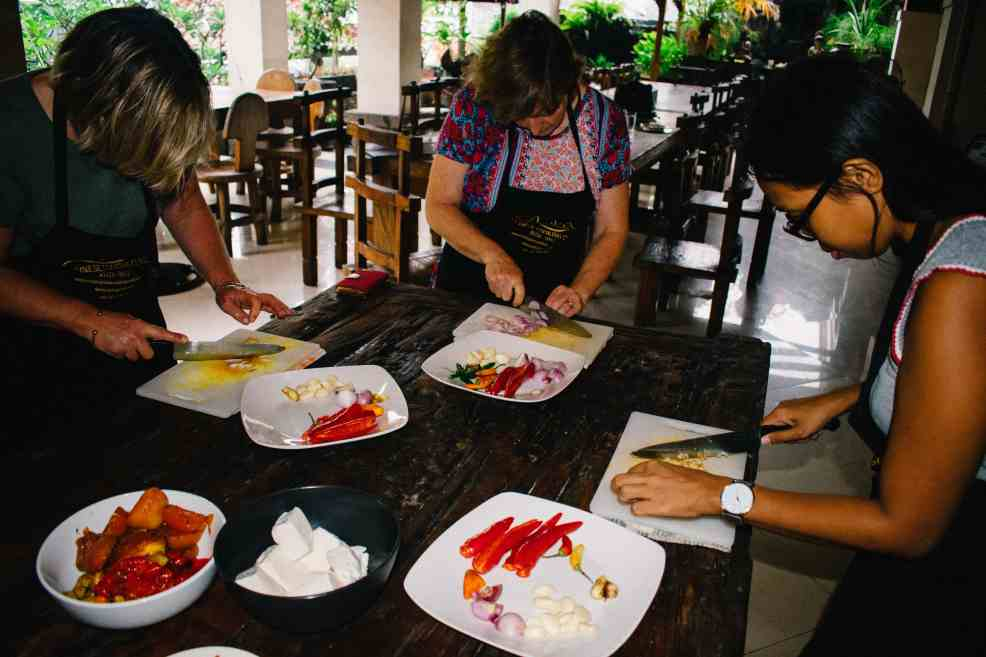 The Bali cooking class starts with the proper cutting of vegetables and spices.