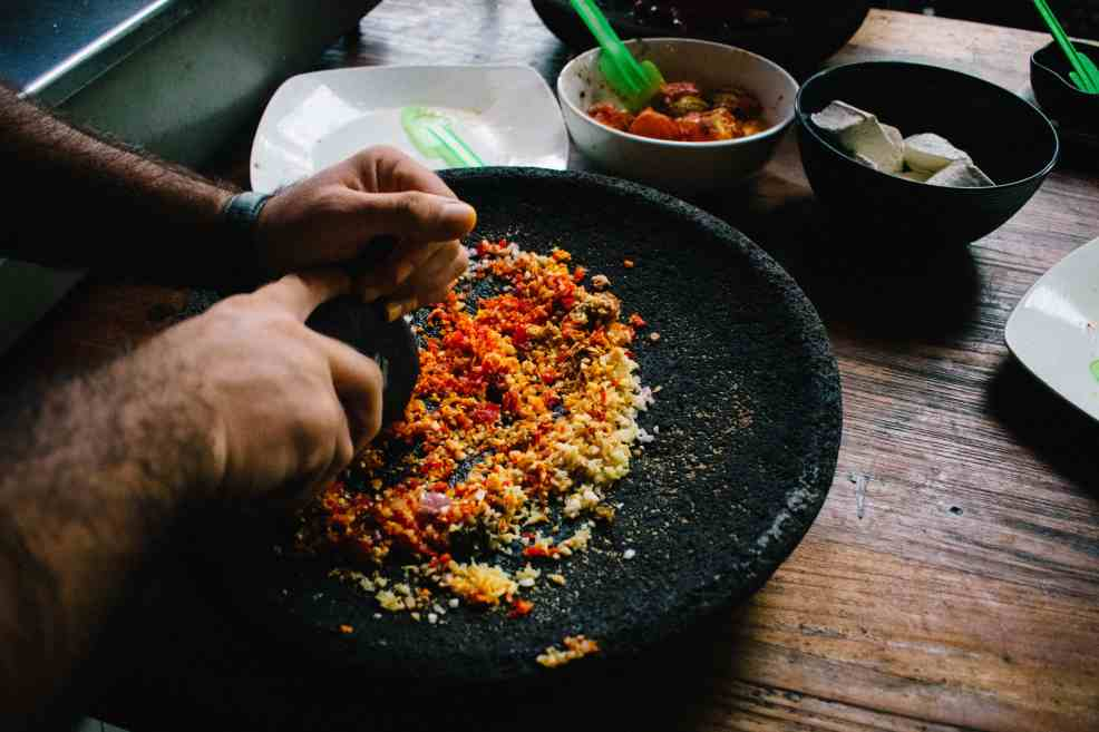 Grinding the spices the right way, with the Balinese mortar and pestle.