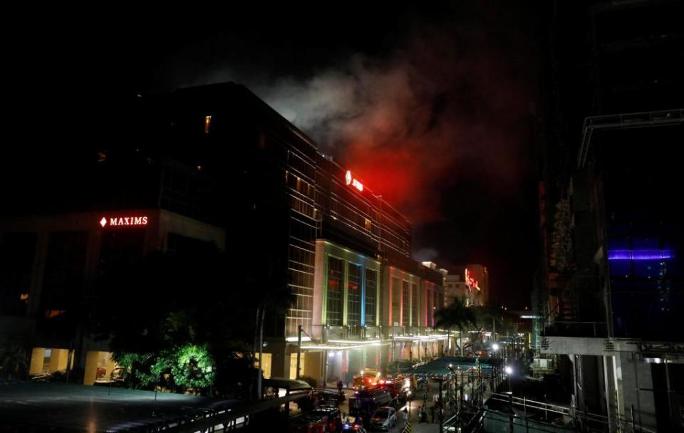 Smoke billows from the Resorts World building in Pasay City, Metro Manila, Philippines. (Reuters Photo)