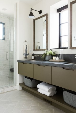 33Guest+bathroom+with+olive+green+cabinets+and+dark+countertops+and+limestone+herringbone+floors