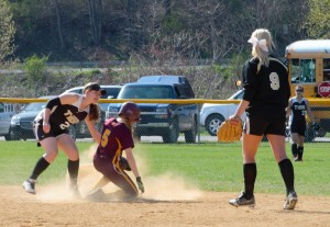 CLOSE AT SECOND - Curwensville shortstop Cheyenne Pentz holds the tage on Elk County Catholic's Maddy Schneider and looks for the call.  Schneider was called safe to help ECC to a 5-0 vidctory.  Second baseman Taylor Goodman (9) and leftfielder Abby Johnson look to back up the play. (photo by Rusty McCracken)