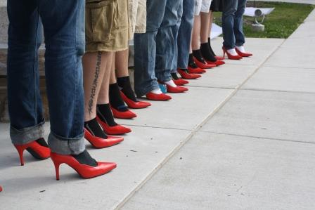 Men lined up in their red high heels during last year's Walk a Mile in Her Shoes. (Provided photo)