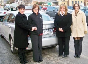 Shown, from left, are Michele Fannin, auxiliary president, handing the Civic keys to Kathy Gillespie, CCAAA Inc. chief executive officer.  Also present were Vicki Myers, auxiliary treasurer, and Ranea Brewer, auxiliary vice president. The auxiliary provided the remaining funds not covered by the AFIG grant to purchase the Honda Civic. (Provided photo)