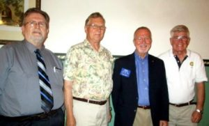 Shown are Assistant District Governor Calvin Thomas, Ron Strattan, Bennett and Club President Joe White. (Provided photo)