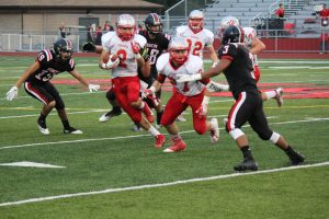 Alex Hoenstine (2) led the Dragons in rushing, passing, and scoring against the Bison.