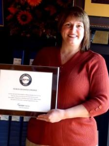 Jackie Syktich, president/chief executive officer of DuBois Business College, is shown holding a plaque honoring the school's most recent distinction, being named as a Military Friendly School for 2014. (Provided photo)