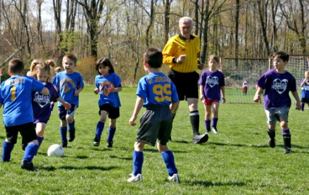 """CSA Pee Wee Soccer game with referee Dwight """"Skip"""" Koerber. Koerber, who passed away June 7, 2015, was well-known in the community through his genuine passion for the sport of soccer and his devotion to the Clearfield Soccer program over the past thirty years. Koerber was a partner Coordinator of the CSA Capital Improvement Campaign, and inspirational in getting the modernization project off the ground. (Provided Photo)."""