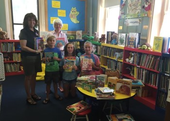 Shown, from left, are United Way treasurer, Brenda Terry; library volunteer, Georgie Danko; and library patrons, Nolan Hite, Emily Greenawalt and Cece Hite. (Provided photo)