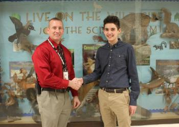 DuBois Area High School Assistant Principal Brian Mulhollan, left, congratulates Corey Giles, who won the first place award at Pennsylvania Junior Academy of Science regional competition held at Penn State Altoona. (Provided photo)