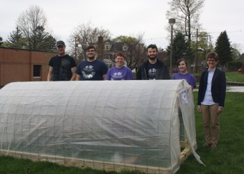 Students Coby Gardner, Ryan Lingle, Kristy Hanes, Austin Miller and Cortney Hedlund donated their mini high tunnel to DuBois Community Garden Volunteer Melinda Hall. (Provided photo)