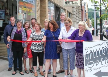 Pictured, from left in the first row, are: Main Street Manager, Loretta Wagner, CRC, and SRACC board member; Martha Bloom, SRACC board secretary; Dottie Spera, SRACC board member; Jody Grumblatt, SRACC board president; and Rebecca Ogden, SRACC member. In the second row, from left, are: Brian Musser; Kathy Marino, Willard Dominick's daughter; Perry Winkler of Winkler Gallery; Linda Schultz, SRACC member; and John Sobel, Clearfield County Commissioner.  Clearfield Operations Borough Manager, Leslie Stott; Jacque Zitzelberger; Beverly Owens; Jane Lee Yare Woolridge; Casen Zitzelberger; and Steve Hindman, past SRACC president, were present but not pictured.  (Provided photo)