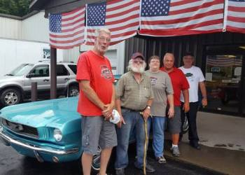 David Blommen of Brockway, Pa., was the winner of the 1966 Ford Mustang that was given way at the 41st annual Antique & Custom Auto Show held by Central Mountains Region AACA.  From left are David Raecher, president; Blommen; Penny White, secretary/treasurer; Walt Gormont, member; and Rich Yarger, vice president. (Provided photo)