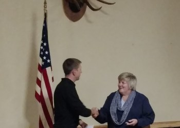 Bev Lawhead, Past Exhalted Ruler left, presents a donation to Jim Mc Corkle, Parker dam and S.B. Elliot state park manager at Tuesday's annual donation dinner at the Benevolent and Protective Order of Elks, Clearfield Lodge #540. Since 1989, the Elks Past Exalted Rulers Association has hosted the High Country Arts and Crafts Fair. Money generated from the fair is then donated to local charities and civic organizations. This year, the Elks donated over $7,000 to organizations in Clearfield and the surrounding areas. (Photo Submitted)