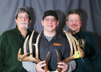 Ron Shaulis is shown holding his record-breaking typical whitetail deer rack taken with a compound bow on Oct. 24, 2017. From left are: Official Boone and Crockett Club scorer Ray Brugler, Ron, and Game Commission Big-Game Scoring Program Coordinator and official B&C Club scorer Bob D'Angelo. (Provided photo)