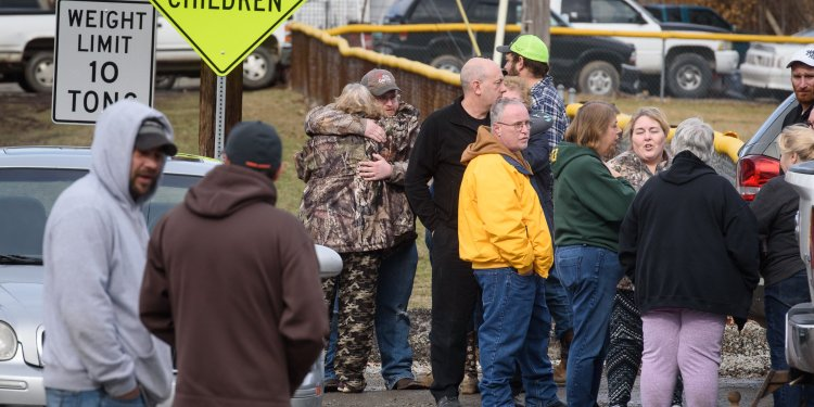 **This image is for use with this specific article only.**  Family members and friends console each other after four people are killed at a Pennsylvania car wash.  Full Credit: Getty Images North America/Getty Images