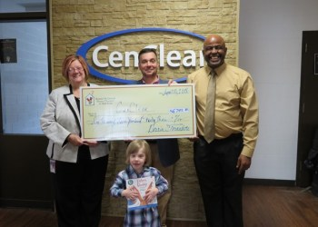 Pictured are Darin Tornatore, president of Ronald McDonald Charities of Mid-Penn (center), who is presenting a check to Cen-Clear Chief Executive Officer Pauline Raab (left) and Sean Rockmore, Cen-Clear family and community partnership and pre-school mental health coordinator. Also pictured is Violet Patterson, 3, of West Decatur.  (Provided photo)