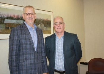 Mike Nesbit, vice president and personal lines manager, at left, with George Heigel, president, support the Penn State DuBois Open Doors Scholarship Program through their business, Swift Kennedy and Company Insurance. (Provided photo)