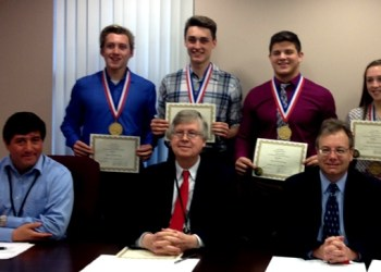 On Tuesday the Clearfield County Commissioners presented certificates to wrestler Luke McGonigal and swimmers, Luke and Paige Mikesell and Chase Bietz. All four recently won state titles. (Photo by GANT News Editor Jessica Shirey)