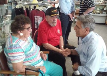 """A small crowd of just over 30 people turned out for a rally at the Grice Museum in Clearfield on Wednesday evening to meet Lou Barletta, who is running against Bob Casey for his seat in the U.S. Senate. Barletta is shown talking to Emily Grimminger and Lynn """"Scoot"""" Grice. (Photo by Wendy Brion)"""
