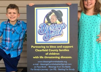 Brody Lanich and his big sister, Khloe, proudly display a poster introducing the Blessings from the Battle Foundation founded by the Lanich, Gabel and Bressler families to support and bless children and families of Clearfield County dealing with serious medical diagnoses. (Provided photo)