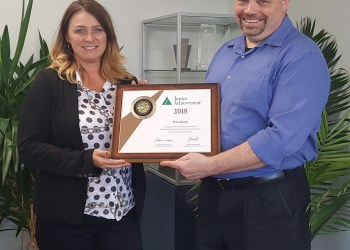 Erin Heath receives a Bronze Leadership Award from Greg Sands. (Provided photo)