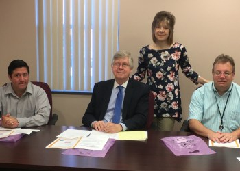 Pictured, in front from left, are Commissioners Tony Scotto, John A. Sobel, chair, and Mark B. McCracken. In the back is Mary Brown, Clearfield-Jefferson Suicide Prevention Team coordinator. (Photo by GANT News Editor Jessica Shirey)