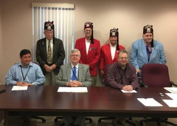 Pictured, in front, are Commissioners Tony Scotto, John A. Sobel and Mark B. McCracken. In back are: Ed Blakely, president; Darrell Kephart, Oriental Band; Roul Jacobson, Oriental Band; and the Rev. Dr. Robert Ludrowsky, secretary/treasurer. (Photo by GANT News Editor Jessica Shirey)