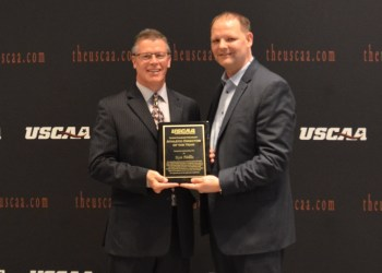Penn State DuBois Athletic Director Ken Nellis, left, accepts his Athletic Director of the Year Award from Michael Fischer, president of the USCAA Board of Directors.   (Provided photo)